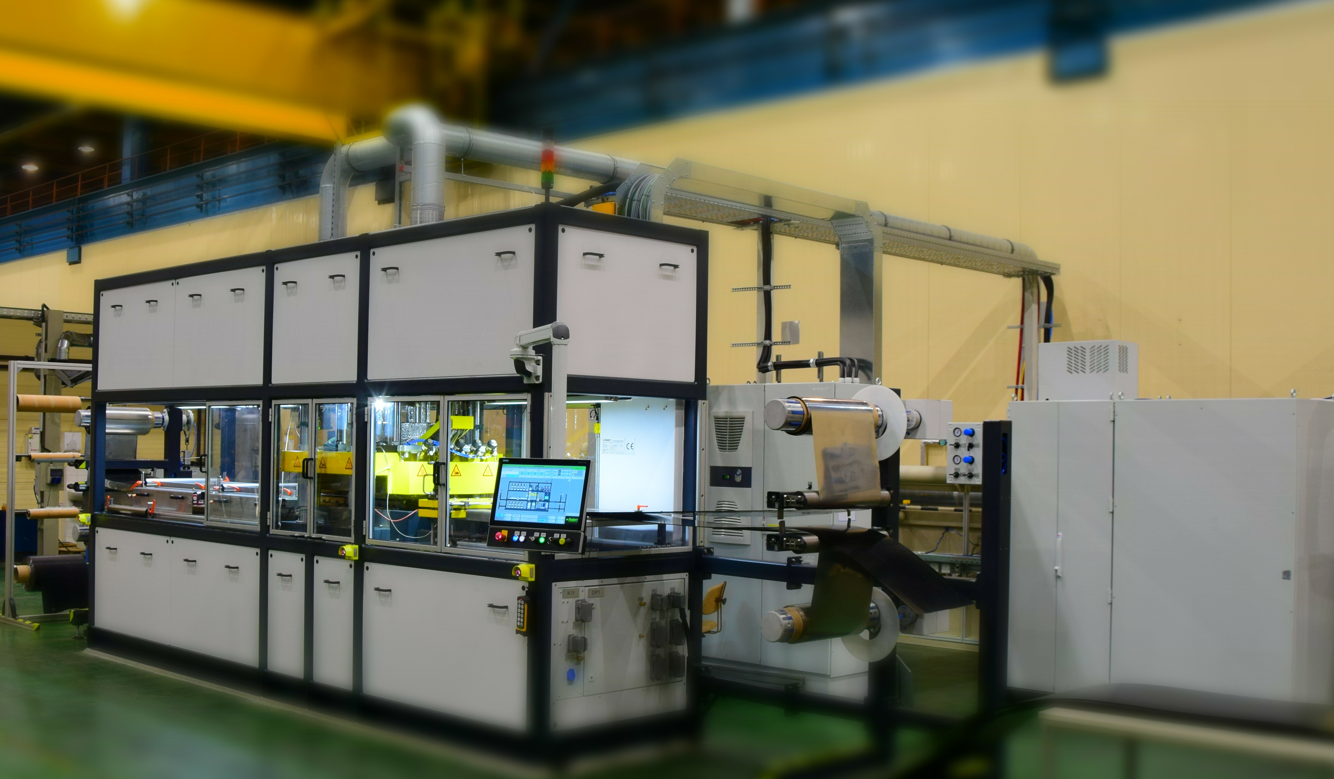The picture shows the overall view of the CCM Molding System IHP 100/66 CCM of the company Teubert Maschinenbau GmbH